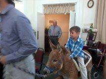 Graylin on donkey - Palm Sunday